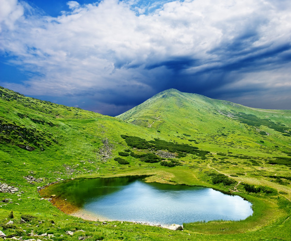 Hills of a small lake, blue sky and white clouds high definition picture