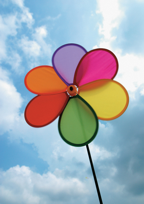 Rainbow windmill under blue sky HD picture HD pictures