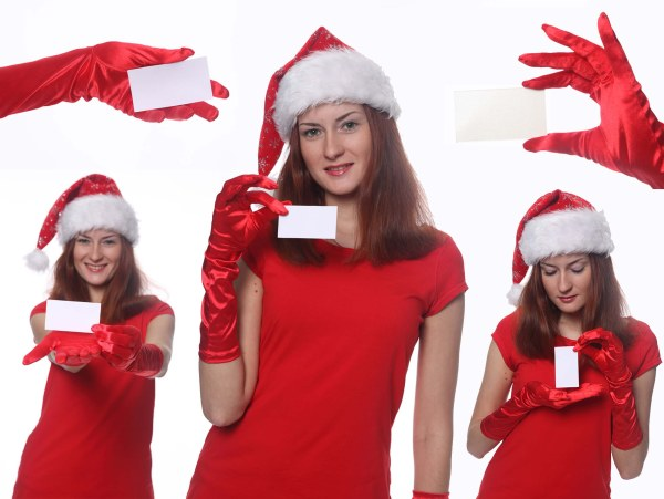 5 Christmas girl holding blank card Images