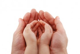 Adult hands holding baby hands Images