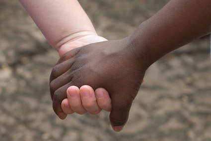 Images of whites and blacks, hand in hand