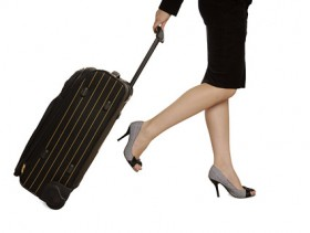 The woman pulling suitcases Images