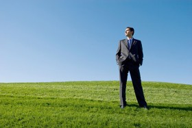 Images of successful people standing on the grass