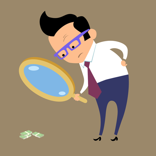 Magnifying glass and business figures